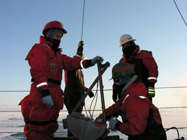 researchers  collecting arctic sediment