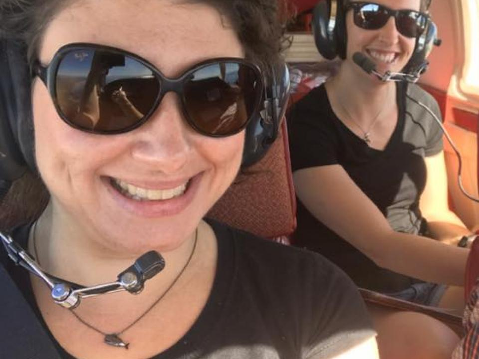 DolphinWatch research assistants Amber Fandel and Leila Fouda ready for their flight.