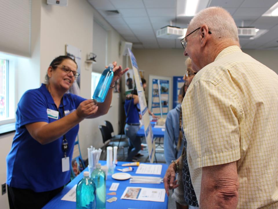 Carys Mitchelmore talks to visit visitor at CBL Open House