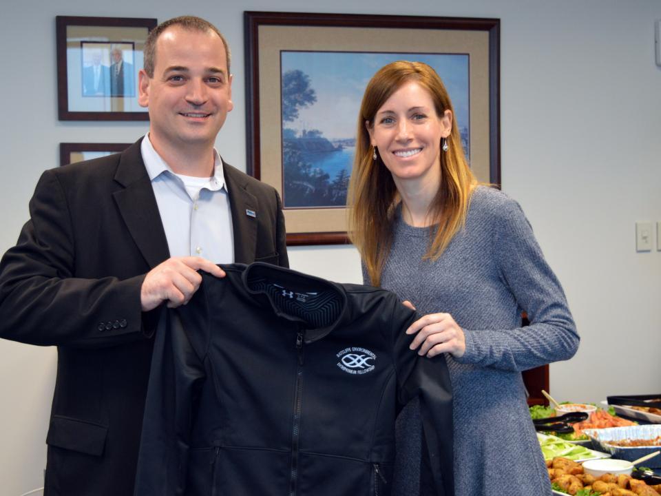 Mary Larkin receives her REEF jacket from Nicholas Hammond.