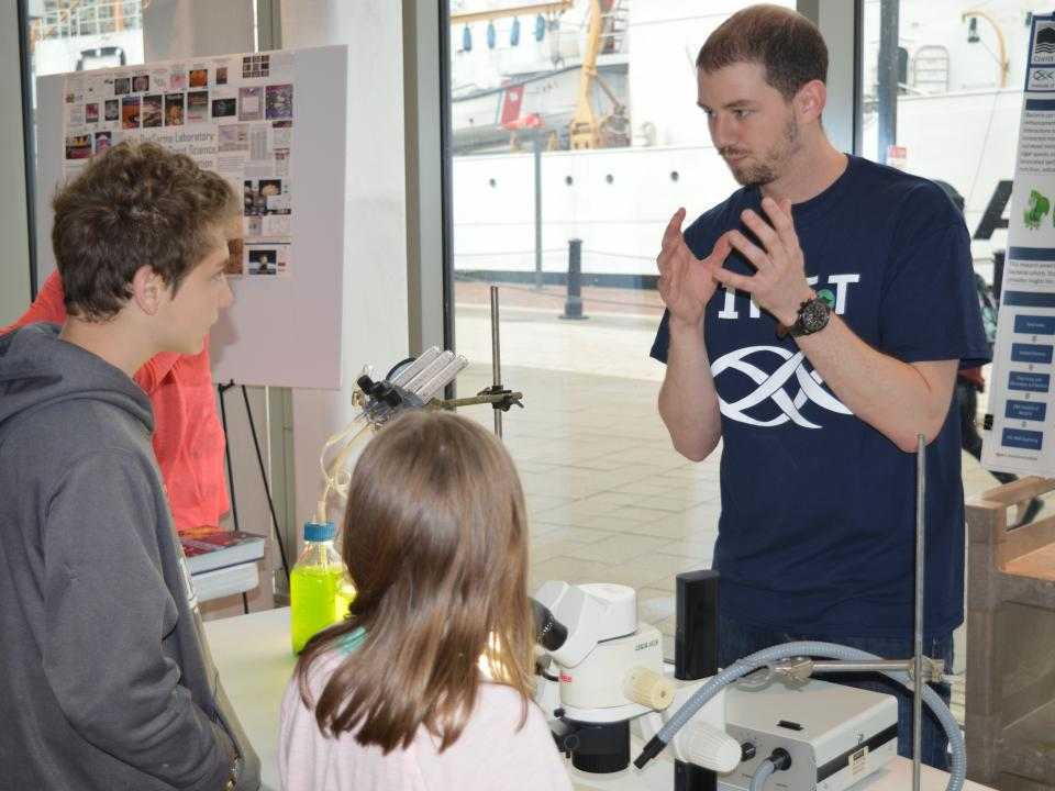 Sam Major talks about his research at IMET during the Open House.
