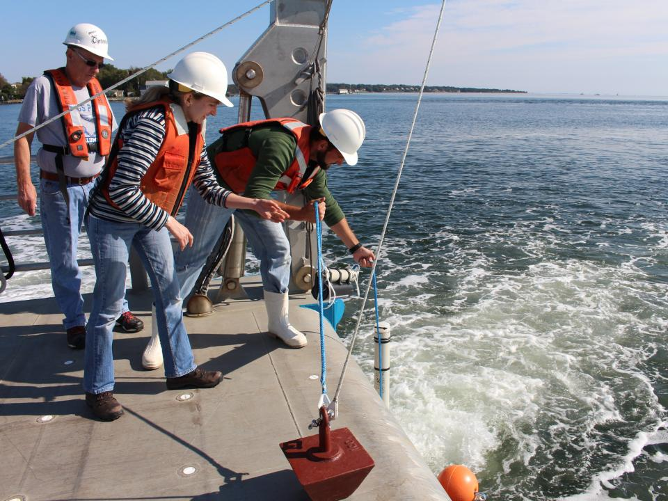 Testing water off the Rachel Carson Research Vessel