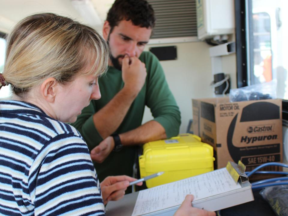 Helen Bailey works with a student on the Rachel Carson.