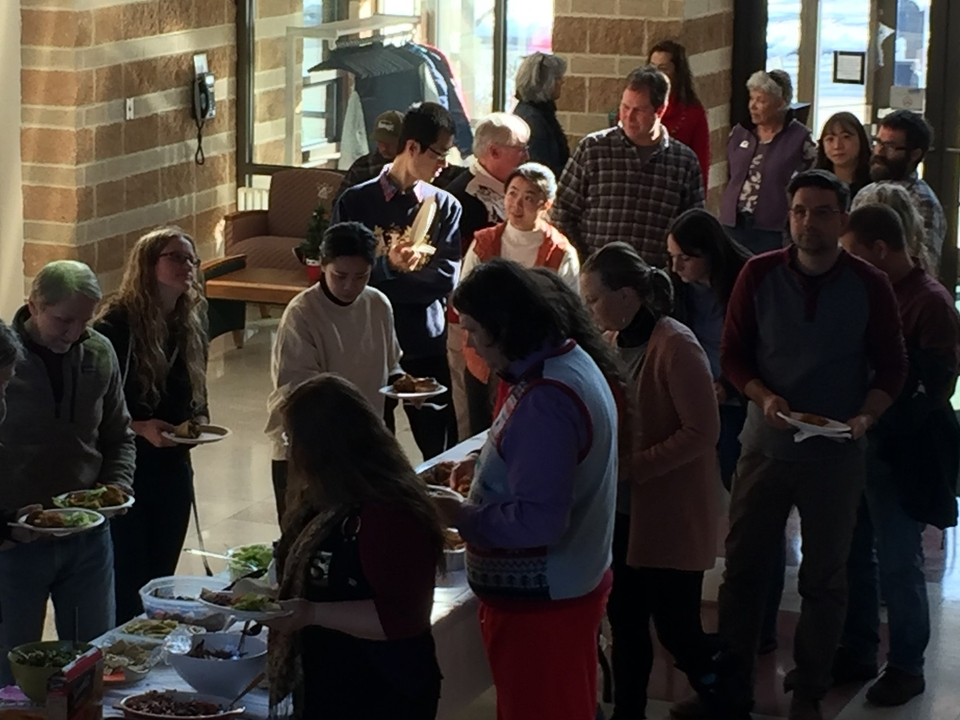 AL faculty, staff and students in buffet line in December 2019