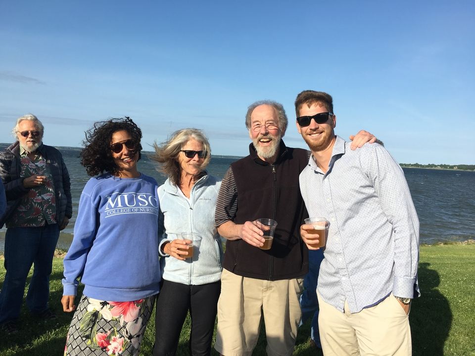 Michael with his family on Horn Point Lab's campus. Left to right: daughter-in-law Marissa, wife Laura Murray, Michael, and son Cullen.