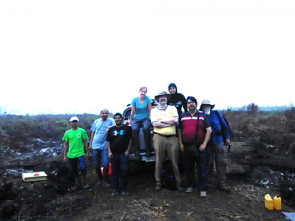 Mark Cochrane poses with his research team during field work.