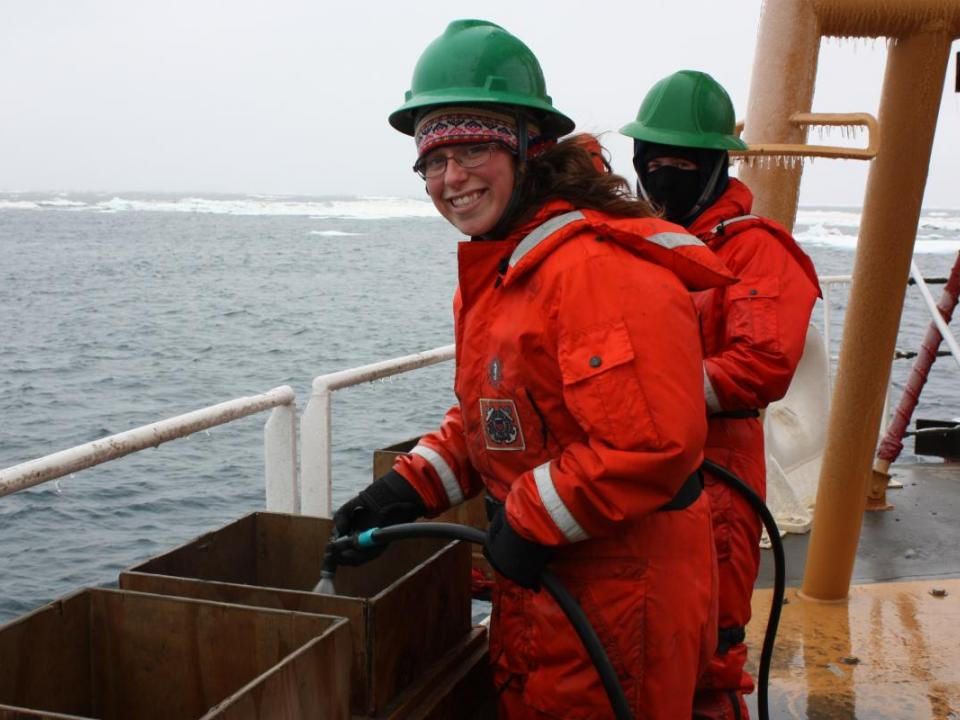 Christina Goethel hoses down benthic samples she needs for her master's research.
