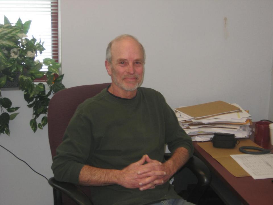 Craig Hartsock seated at desk.