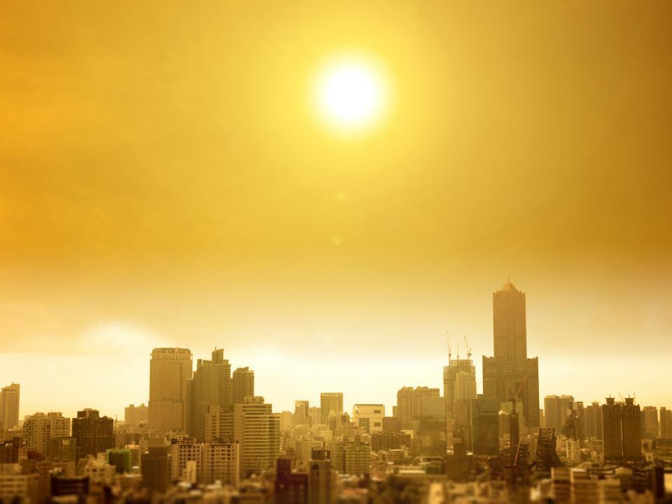 Future urban landscape with orange sky.