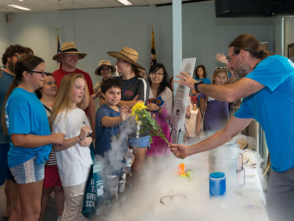 Dr. Michael Gonsior wow-ing the crowd with his liquid nitrogen experiment