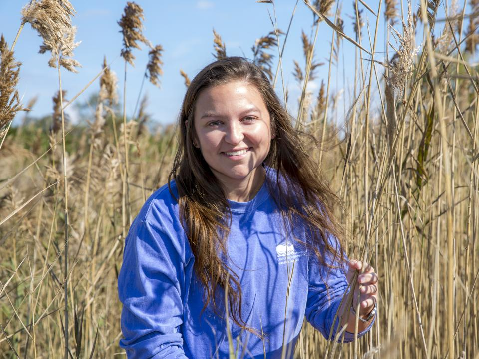 Hannah Morrissette pictured in a coastal marsh