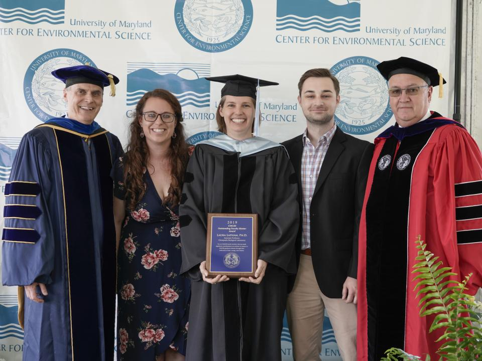 UMCES President Peter Goodwin, Graduate Student Council Chair Christina Goethel, Faculty Mentorship Awardee Laura Lapham, Graduate Student Drew Hobbs, and Chesapeake Biological Laboratory Director Tom Miller.