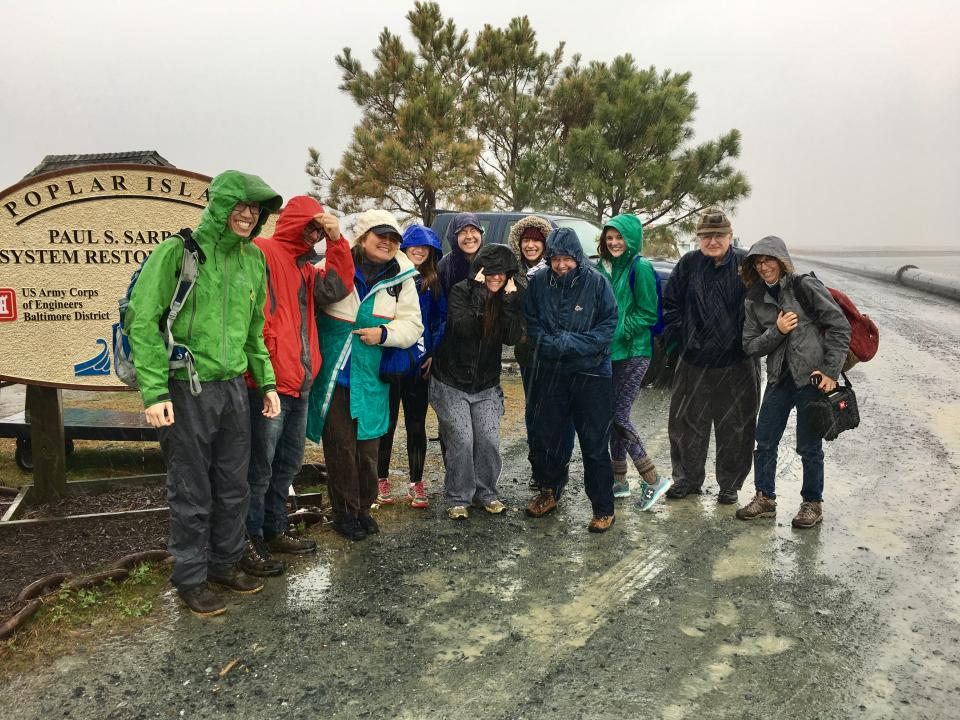 The biological oceanography class poses at the end of its tour of Poplar Island.