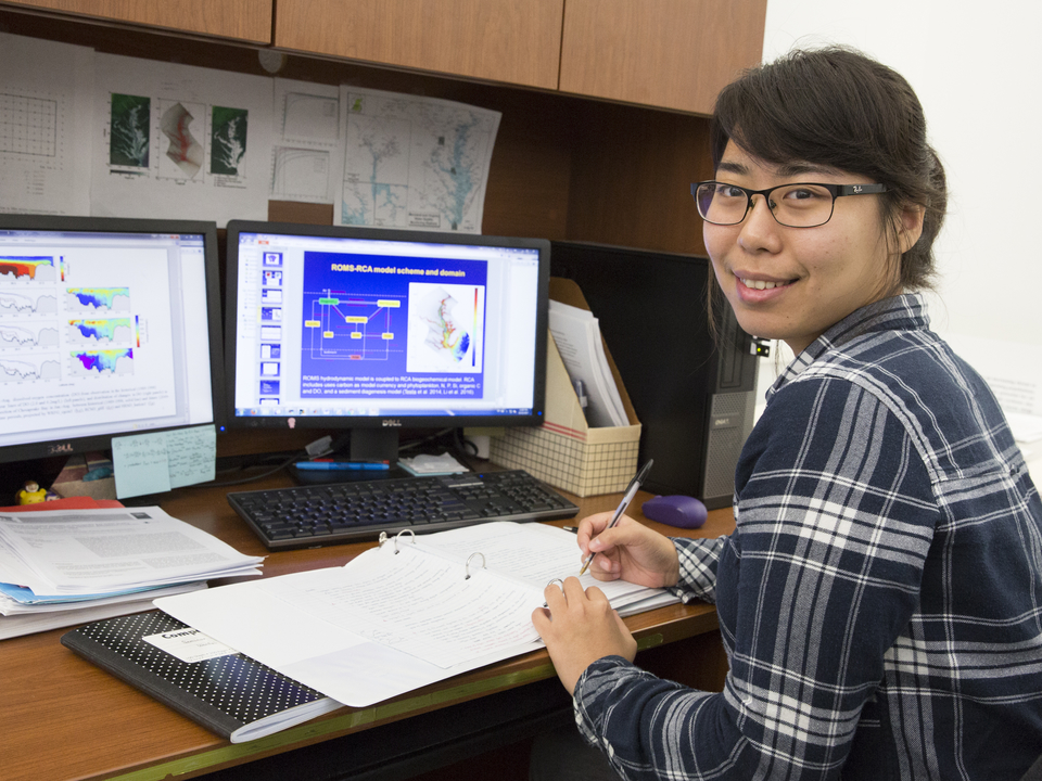 Wenfei at her desk.