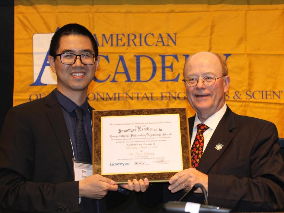 Qian Zhang receives his Innovyze Excellence in Computational Hydraulics/Hydrology Award from Howard B. LaFever, past board president of the American Academy of Environment Engineers and Scientists