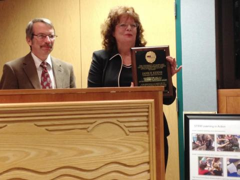 Janice Keene, president of the Evergreen Heritage Center Foundation, accepts the 2015 Richard A. Johnson Environmental Education Award as Appalachian Laboratory Director Eric Davidson looks on.