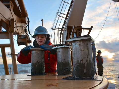 Chelsea Wegner with scientific equipment aboard an arctic research vessel