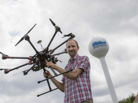 Greg Silsbe with a drone in front of Horn Point Laboratory's water tower