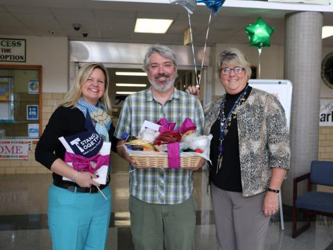 Horn Point Laboratory's Jamie Pierson (center) poses with Easton Middle School Acting Principal Jackie Valcik (left) and Superintendent Kelly Griffith.