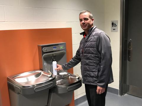 Brian Duke fills up a refillable water bottle at a new water filling station on campus.