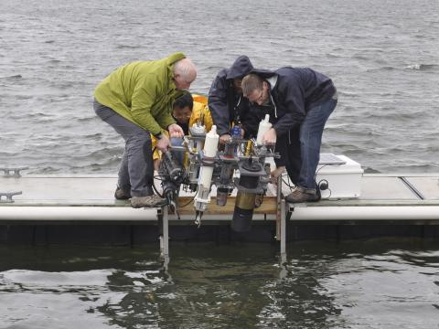Lowering nutrient sensing equipment into the Patuxent River