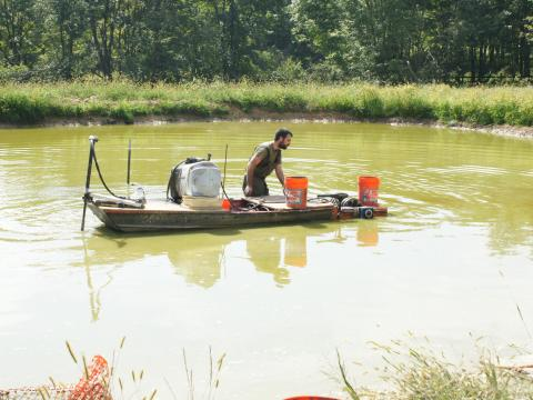 Ryan Powell on boat doing research on algal biofuel