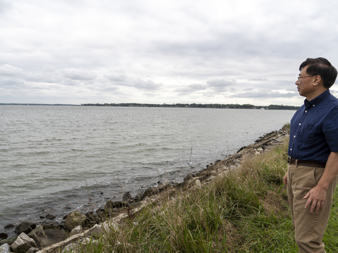 Ming Li outside the Horn Point Laboratory looking out at the Chesapeake Bay