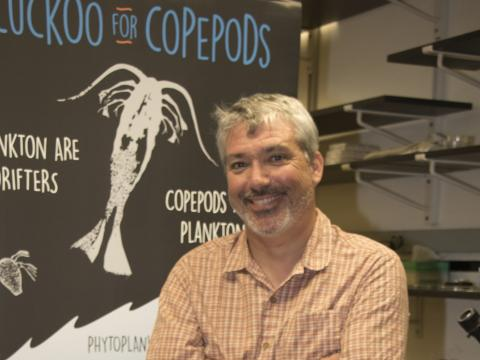 Jamie Pierson with copepod background