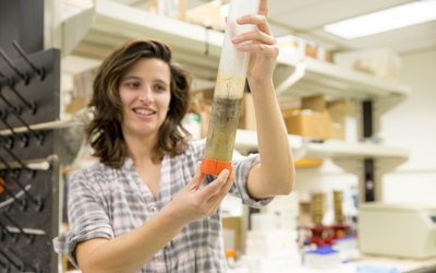 Emily Russ, a graduate student at Horn Point, holds up a sample of sediment. Photo by Cheryl Nemazie