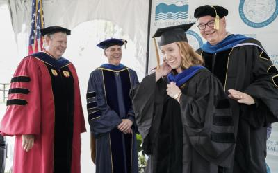 Melanie Jackson is hooded by her mentor Jeff Cornwell at UMCES 2019 Commencement
