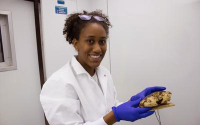 Amanda Lawrence holding a Jonah crab