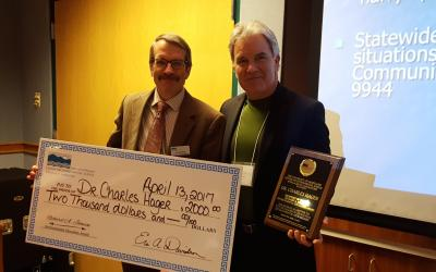 Dr. Hager receives big check for Johnson Award