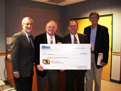 UMCES President Donald Boesch, Appalachian Laboratory Director Raymond Morgan, Johnson Award winner Tom Mathews, and nature writer Tom Horton.