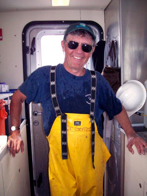 Walter Boynton, dressed for work on the Bay, poses aboard a research vessel.