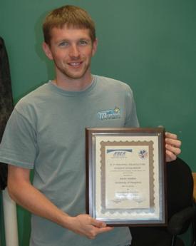 IMET's Aaron Watson earns an award.