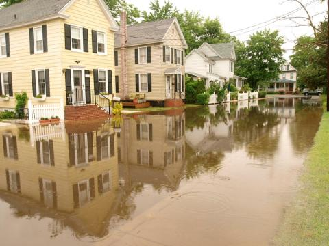 Houses surrounded by high water in Cambridge, MD by Dave Harp