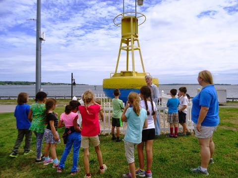 A school class participates in a group tour at the Chesapeake Biological Laboratory