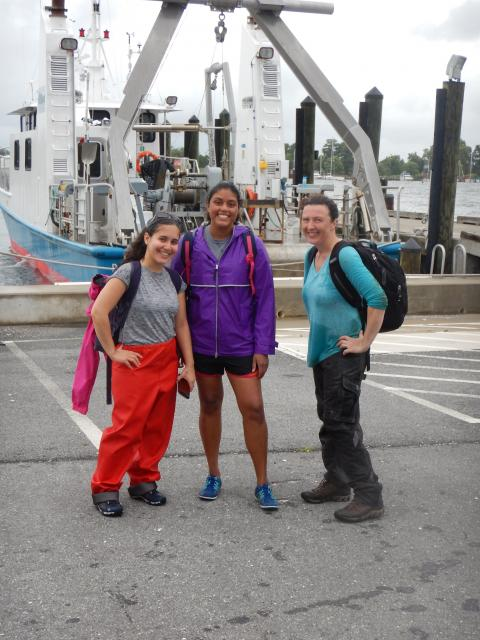 Chesapeake Biological Lab students on a dock in front of the R.V. Rachel Carson