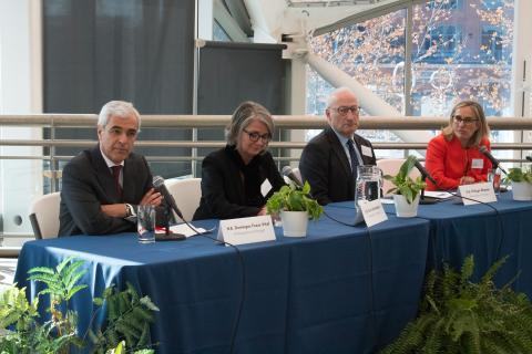 Four EU Ambassadors sit at a panel at IMET