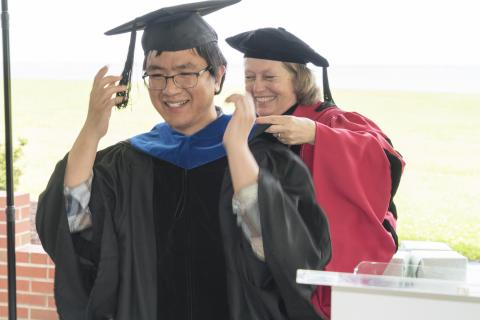 Graduate Fan Zhang is hooded by Professor Pat Glibert at UMCES' 2018 Commencement.