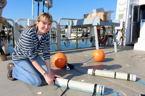 Helen Bailey with acoustic monitoring equipment