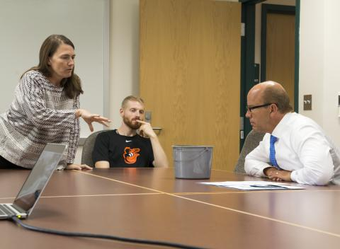 Photo of Katia Engelhardt discussing Vallisneria restoration and ecology with Representative John Delaney