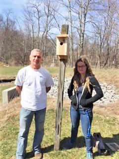John Piasecki, AL Facility Manager, and Claire Nemes, Ph.D. student, with installed bluebird box.