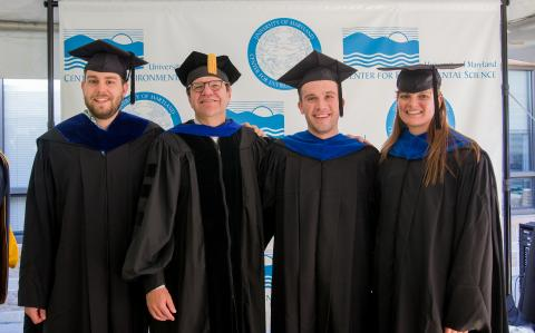 David Secor poses with the graduates who earned degrees for fisheries studies.