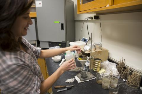 Emily Russ works in the lab.