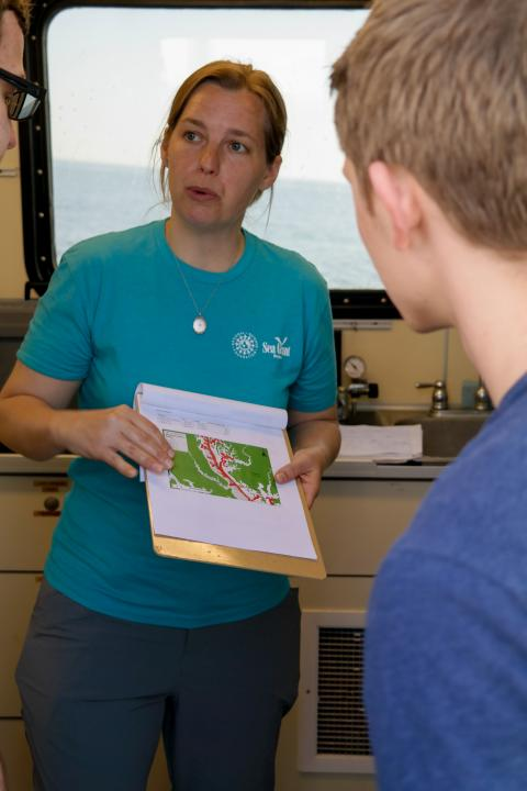 Scientist Laura Lapham talking to students on the Rachel Carson research vessel