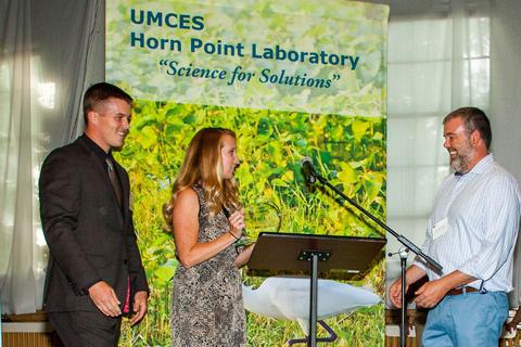 HPL students Blake Clark and Melanie Jackson presenting CC 2017 award to Jim Brighton