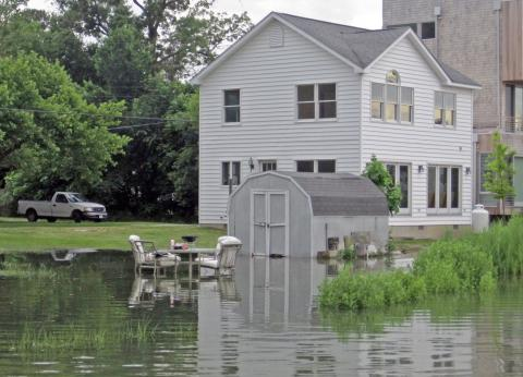 A house surrounded by flood water on the Eastern Shore of Maryland.