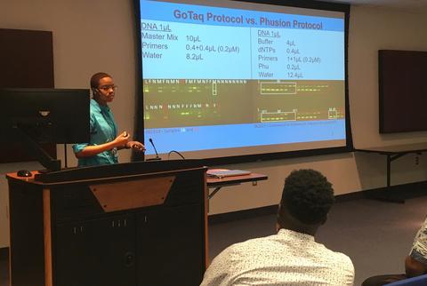 A student gives a presentation at the IMET summer internship program.
