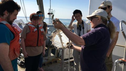 Professor Judy O'Neil shows the students a net that will be used to catch plankton from the Choptank River.